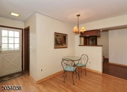 Have a cup of coffee or dinner in this open area off of the kitchen and family room.