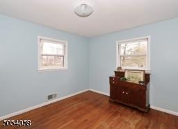 Second bedroom . hardwood floors and freshly painted.