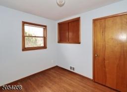 Third bedroom hardwood floors and freshly painted.
