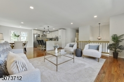 Open concept, wood flooring, recessed lights with dimmer.