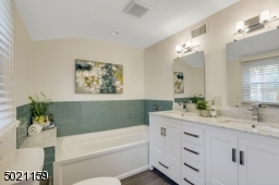 Indulge in the luxurious feeling of bathing in this spa-like bathtub and walk-in shower.  Double sinks, wood vanity and beautiful marble & tiles add to your soothing private escape!