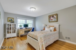 Spacious bedroom features hardwood floors, natural light, great closet space & access to ample attic storage.