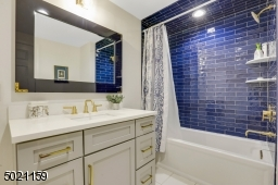 Main bathroom on second floor delights with its upscale fixtures