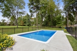 This fenced-in pool has a new liner, all new decking and new pool pump equipment.  You're all set for next season!