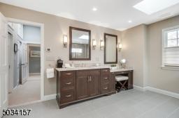 Dual vanities, oversized shower with multiple sprays, radiant heated floors