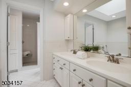 Dial vanities, jetted soaking tub, separate shower