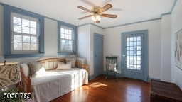 Bedroom #2 offers gorgeous hardwood floors, ceiling fan, high ceilings, French door to terrace and good size closet.