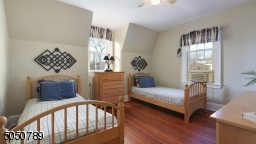 Bedroom #3 offers gorgeous hardwood floors, ceiling fan, high ceilings and bonus study room.