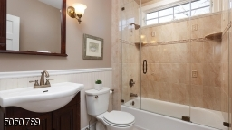 Beautifully remodeled with transom window, seamless glass door tub enclosure, beautiful tiles and fixtures