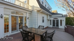 The multilevel deck offers easy access to the family room and breakfast room for a continuous flow indoor and out.