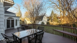 For your outdoor dining pleasure overlooking a beautiful yard, this deck offers built-in seating and plenty of room for your outdoor furniture as well.