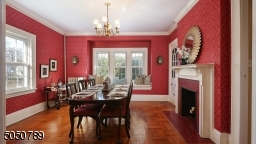 Banquet size Dining Room with Gorgeous Window Seat, Hardwood Floors and crown molding