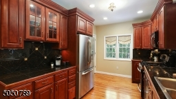 Gorgeous wood cabinetry, stainless steel appliances recessed lights & hardwood floors