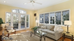 Natural Light streams through gorgeous windows in this fabulous family room with access to Deck & yard