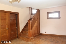 Beautiful woodwork on staircase leading to 2nd floor