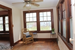 Windows on 2 sides providing lots of natural light in this room.  Can be Family Room, home office, or Sun Room.  Features hardwood floors, ceiling fan