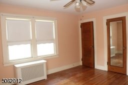 Another viiew of MBR; 2 closets; hardwood floors; ceiling fan