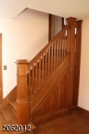 Staircase to second floor; beautiful original woodwork