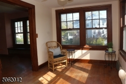 Sun-drenched room w/ lots of windows; great as family room, home office, den