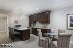 Great for entertaining, we have added the upper cabinets, sink and a wine refrigerator.
