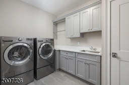 LG washer/dryer, quartz counter tops and upgraded tile flooring.