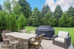 This backyard is one of the most beautiful, quiet locations, backing up to a beautiful tree setting.