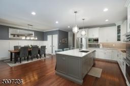 Quartz counter tops, under cabinet lighting and I love the glass backsplash!
