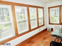 All Seasons Sun filled Sunroom with walls of windows
