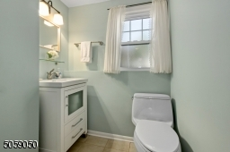 This powder room can be expanded to a full bath. There is an unfinished area with a sink on the other side of the wall where you could put a shower instead.