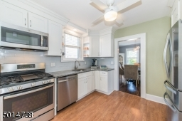 updated stainless steel appliances make this kitchen a pleasure to cook in