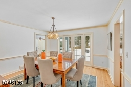 French doors from the dining room lead to the large paver patio & serene park-like property