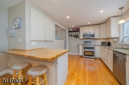 Generous cabinet space and breakfast bar