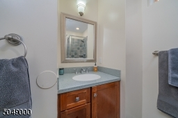 1 of 3 full baths, this one with stall shower