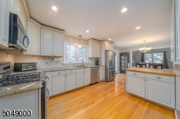 Large kitchen with generous cabinet space; open layout perfect for entertaining