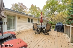 Easy to maintain TREX deck off the kitchen; enjoy al fresco dining in your private backyard