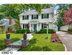 Wonderful curb appeal and beautiful setting on tree lined street
