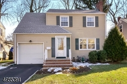 Charming 3 bedroom Colonial with vinyl siding.