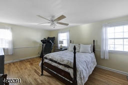 Spacious master bedroom with double and single closets.  Numerous windows and hardwood floors.