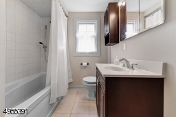 Main bath with shower over tub.