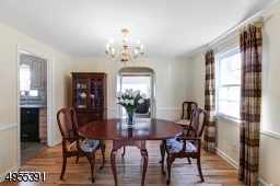 Formal dining room w/hardwood floors opens to family room and kitchen.