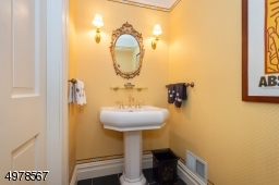 This elegantly appointed powder room serves guests on the main floor.