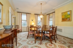 View is from the Great Room into the dining room shown to highlight the number of windows.  Note deep crown and base moldings and hardwood floor