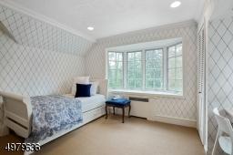 two closets, wood floors under carpet
