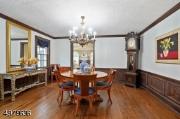 spacious formal dining room with crown molding, wood floor