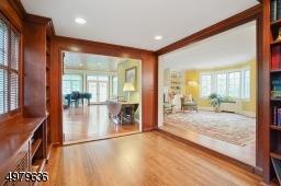 wood trim, built ins, hardwood floors