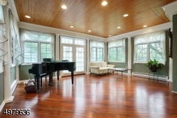 sun-lit & windowed, hardwood floors, french doors lead to the bridal staircase, patio to side yard