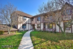 Wrapped around lovely level grounds. Pool/Tennis Ct for residents.