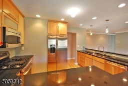 Tons of cabinetry, double sinks, wine refrigerator and great stainless steel appliances.