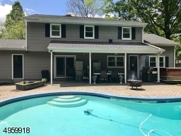 with pool, paving patio, hot tub and barbecue area