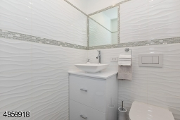 with heated floor, hanging toilet